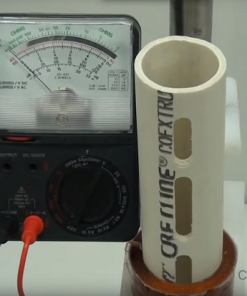 Photo of volt meter and PVC pipe with air coil