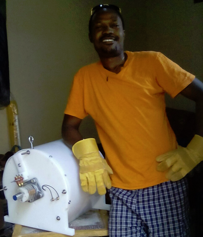 David J. Uganda black man standing next to white Fuel less Engine SP500 Generator model 2