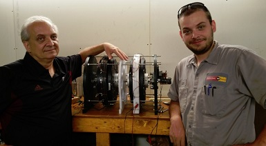 man and dad standing next to our SP500 Generator model 2 they built