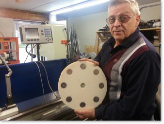 Satisfied customer holding a white magnet rotor with magnets
