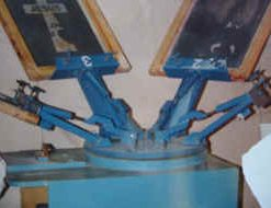 Photo of our JCM1 5 color screen printing machine, in blue